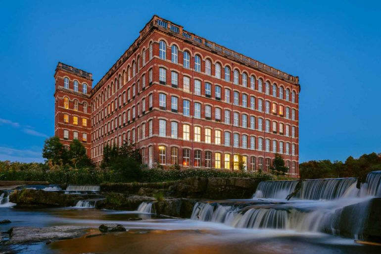 Anchor Mill building and the waterfalls at twilight