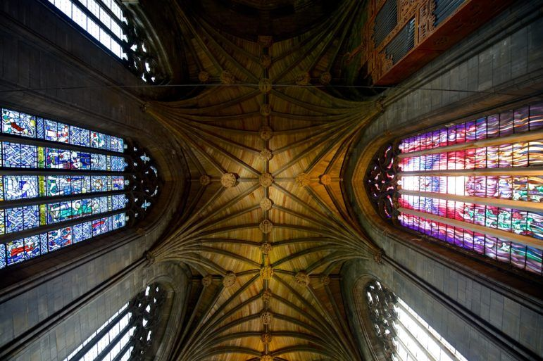 View of Paisley Abbey roof and stain glass windows taken from the floor looking up