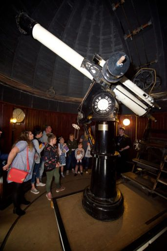 Group of people looking at the telescope at Paisley observatory