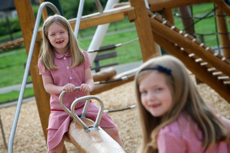 Girls play on see-saw in Barshaw Park