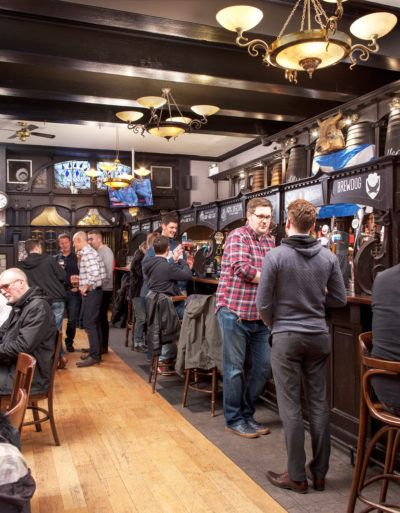 People and students drinking in Paisley pub, The Bull