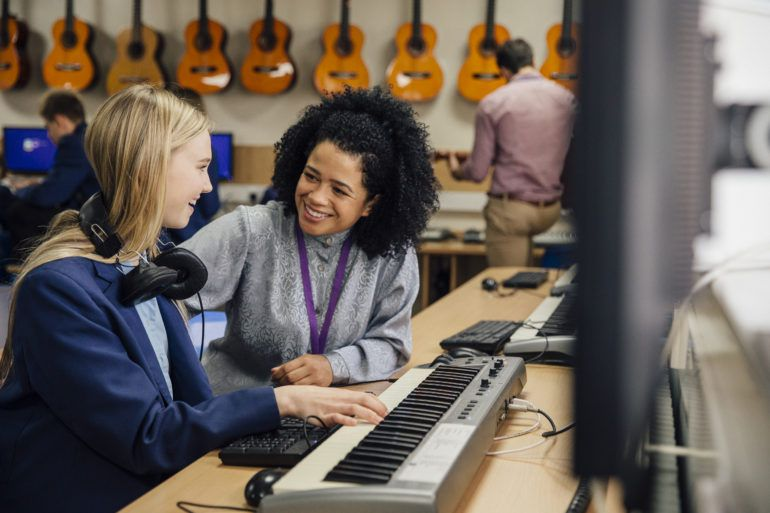 Renfrewshire pupil learning keyboard in High School Music Lesson