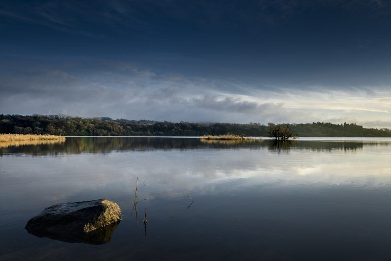 Calming waters of Castle Semple Loch at Clyde Muirshiel
