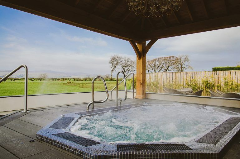 Renfrewshire's Spas Bowfield Outside Hydro Pool with view of countryside