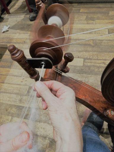 Hands spinning thread